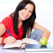 Stock Photo: Smiling brunette womstudying