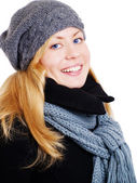 Smiling blond woman in winter clothes po — Stock Photo