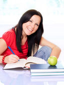 Smiling brunette woman studying — Stock Photo