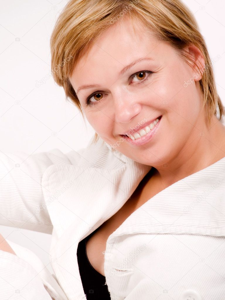 Beautiful smiling blond woman in white coat — Stock Photo #1598756