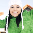Woman in winter clothes enjoy in front o — Stock Photo
