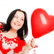 Smiling woman holding valentine heart ba — Stock Photo