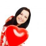 Smiling woman holding valentine heart ba — Stock Photo