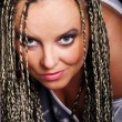 Portrait of vamp woman in braids - Stock Photo