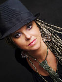 Party woman with braids in hat — Stok fotoğraf
