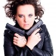Woman in leather wear holding gun over w — Stock Photo