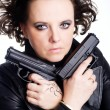 Woman in leather wear holding two guns — Stock Photo