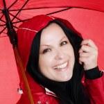 Smiling brunette woman in rainproof — Stock Photo #1851565