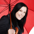 Стоковое фото: Smiling brunette woman with umbrella