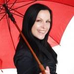 Smiling brunette woman in fall, rainproo — Stock Photo