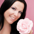 Beautiful woman with pink rose — Stock Photo #1851832