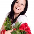 Smiling woman with bouquet of roses — Stock fotografie