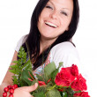 Femme souriante avec bouquet de roses — Photo