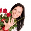 Smilling woman with buquet of roses — Stock Photo