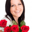 Smiling woman with bouquet of flowers — Stock Photo