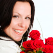 Smiling brunette woman with bouquet of f - Stock Photo