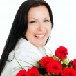 Smiling brunette woman with bouquet - Stock Photo