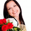 Smiling brunette woman with bouquet — Stock Photo #1852048