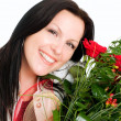 Smiling brunette woman with bouquet — Stock Photo