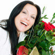 Smiling brunette woman with bouquet — Stock Photo #1852105
