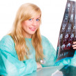 Female doctor holding examining x-ray — Stock Photo #1854459