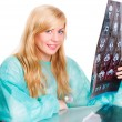 Stock Photo: Female doctor holding examining x-ray