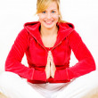 Smiling blond woman exercising yoga — Foto de Stock   #1854560