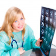 Foto Stock: Female doctor examining x-ray