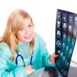 Female doctor examining x-ray — Stock Photo