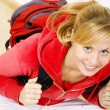Teenager sitting with backpack — Stockfoto