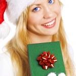Christmas woman holding present — Stock Photo