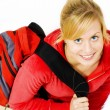 Foto Stock: Smiling teenager with backpack