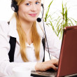Woman with headphone in office — Stockfoto