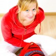 Smiling blond teenager sitting on floor — Stock Photo #1855360