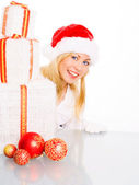 Christmas woman holding present — Stock Photo
