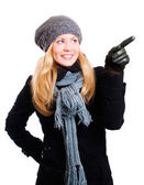 Woman in winter clothes pointing — Stock Photo