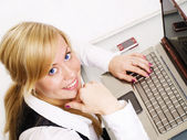 Woman working with computer — Stock Photo
