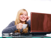 Woman sitting with computer — Stock Photo