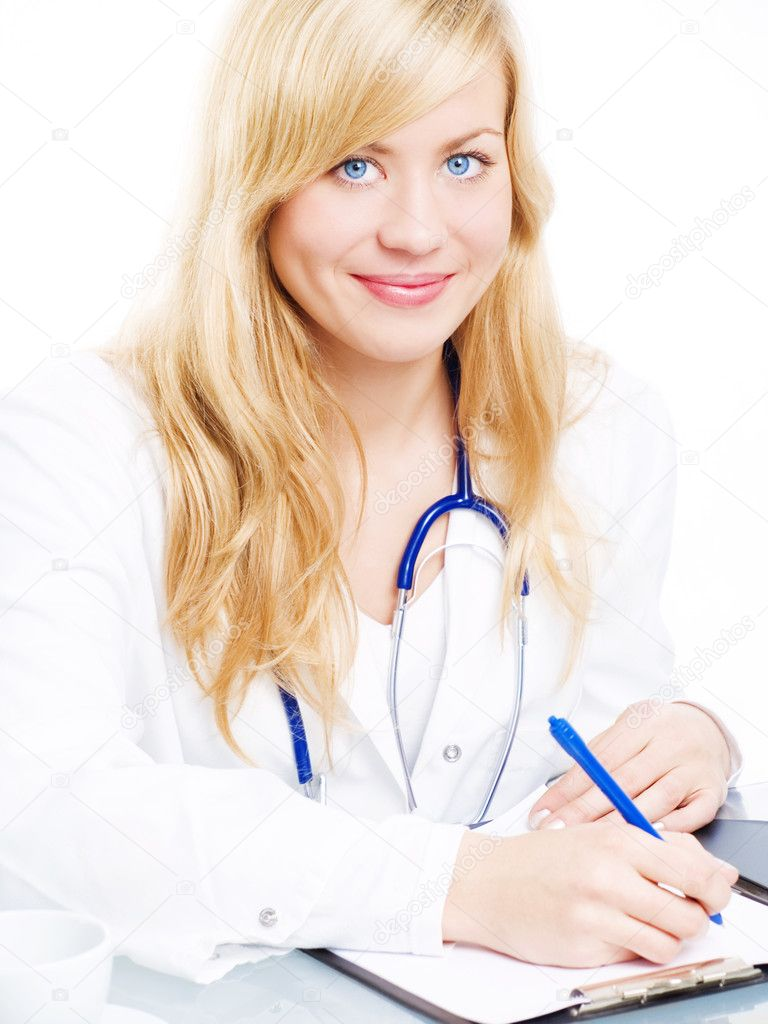 Smiling female doctor with stethoscope sitting and writting notes — Stock Photo #1854631