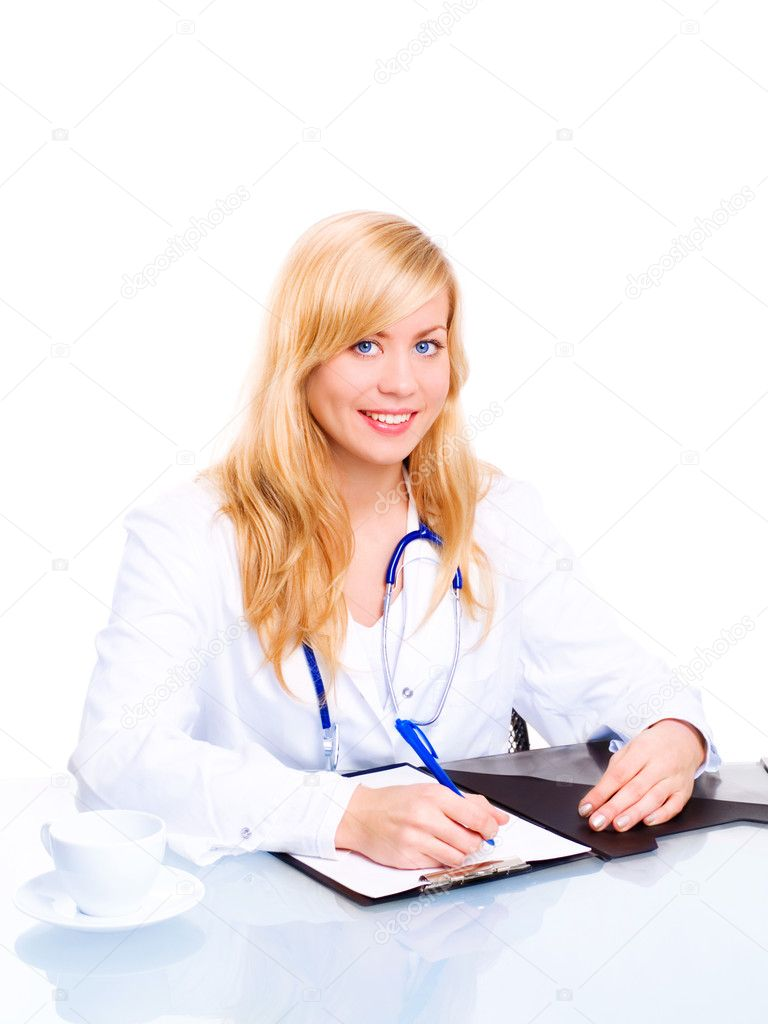 Smiling female doctor with stethoscope sitting in office and making some  notes — Stock fotografie #1854726