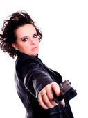 Woman in leather wear holding gun — Stok fotoğraf