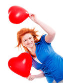 Girl holding two valentine balloon heart — Stock Photo