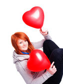Girl holding two valetine balloon heart — Stock Photo