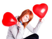Girl holding valetine balloon heart — Stock Photo