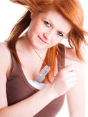 Red girl with dogtags over white — Stock Photo