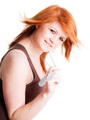 Red girl holding dogtags over white — Stock Photo