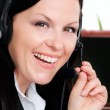 Woman with headphone in office — Stock Photo