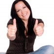 Woman with her thumb up — Stock Photo