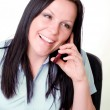 Woman calling by phone in office — Stock Photo #2094369