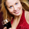 Smiling beautiful woman holding wine — Stock Photo #2094744